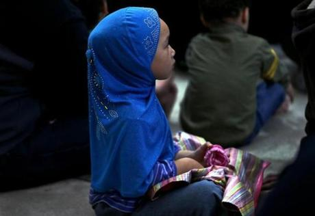 Five-year-old Yasmine Abdullah listened during the prayer service.
